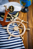 Decorative wooden steering wheel. On an old wooden table Royalty Free Stock Image