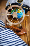 Decorative wooden steering wheel. On an old wooden table Stock Image