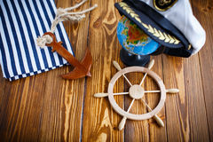 Decorative wooden steering wheel. On an old wooden table Royalty Free Stock Images