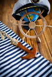Decorative wooden steering wheel. On an old wooden table Stock Photos