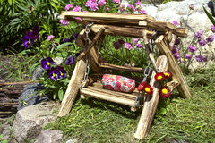 Decorative wooden swing in the garden Royalty Free Stock Photos
