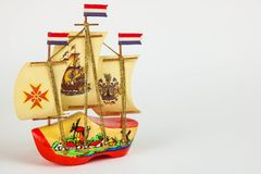 Decorative wooden toys boat, dutch boot-boat on white background. Place for text. Selective focus. Horizontal image royalty free stock images