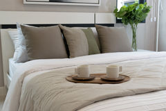 Decorative wooden tray on bed Stock Photo