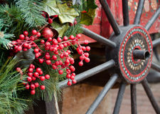 Decorative wooden wheel and red berries in Old town Royalty Free Stock Images