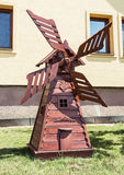 Decorative wooden windmill in the garden, carving art Stock Photos
