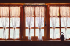 Decorative Wooden Windows and Curtains Royalty Free Stock Photography