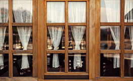 Decorative Wooden Windows and Curtains Royalty Free Stock Image