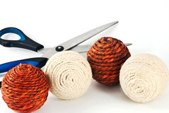 Decorative wool balls with scissors. Four wool balls with scissors situated on the white background Stock Photo