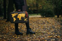 Decorative world map on old travel luggage. Autumn themed. royalty free stock photography