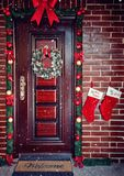 Decorative Wreath. Christmas front door. For holiday Stock Photography