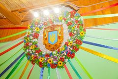 Decorative wreath decoration in the style of Ukrainian patriotis. M with the coat of arms and flowers Stock Image