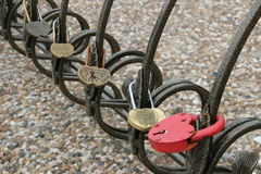 Decorative wrought-iron fence with locks Stock Images