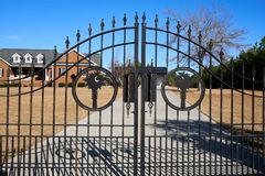 Decorative Wrought Iron Gate with spikes on the top. Decorative wrought iron gate used for decoration and security of a private residence Royalty Free Stock Photo