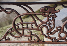 Decorative wrought-iron grille. Fragment of decorative lattice in shape of dragon Stock Photography