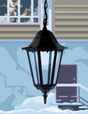 Decorative wrought iron lamp. On the background of the house Stock Image