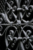 Decorative wrought iron security. A background image of decorative wrought iron with short depth of field royalty free stock image