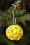 Decorative yellow ball on Christmas tree Royalty Free Stock Photos