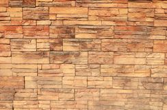 Decorative yellow brick wall for background stock image