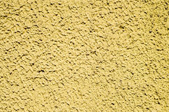 Decorative yellow relief plaster on wall Stock Photos