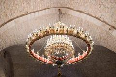 Decoratively decorated chandelier in the Greek Catholic Church in Mi`ilya in Israel. Mi`ilya, Israel, December 22, 2017 : Decoratively decorated chandelier in Stock Photos