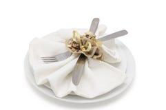 Decoratively folded napkin Stock Photos