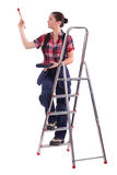 Decorator climbing a ladder Royalty Free Stock Photo