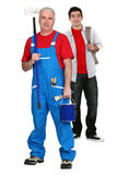 Decorator and his apprentice Stock Photography