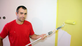 Decorator Holding Paint Roller Stock Photography