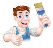 Decorator holding paintbrush Stock Image