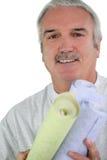 Decorator holding wallpaper. Decorator holding rolls of wallpaper Stock Images