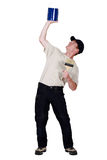 Decorator lifting his paint can. Up high Stock Images