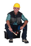 Decorator with a paint brush Stock Image