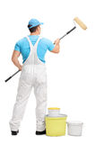 Decorator painting with a paint roller Stock Photo