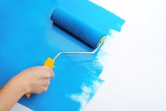 Decorator`s hand painting. Wall with roller Royalty Free Stock Photos