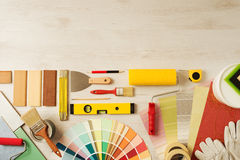 Decorator's work table with tools. Decorating and DIY hobby tools and color swatches with copy space on top, top view royalty free stock photography