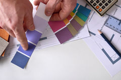 Decorator showing a color tone on work table top view Royalty Free Stock Photography