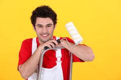 Decorator stood in ladder. Male decorator stood in ladder Royalty Free Stock Photos