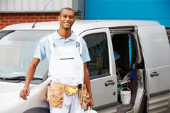 Decorator Wearing Overalls Standing Next To Van. Smiling To Camera Stock Images