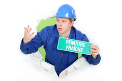 Decorator with a wet paint sign Stock Images