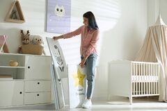 Free Decorator With Pictures Near Wall. Children`s Room Interior Design Royalty Free Stock Image - 195487076