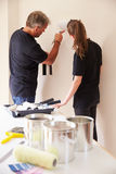 Decorators painting the walls of a house Stock Images