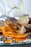 Decorazione arancio sul piatto Fotografia Stock Libera da Diritti