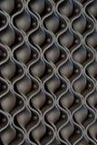 Decorazione d'acciaio ondulata su una parete Fotografia Stock