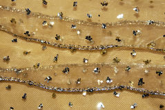Decorazione del tessuto di reticolato dell'oro Fotografie Stock