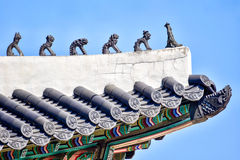 Decorazione del tetto di un padiglione al palazzo di Changdeokgung Immagini Stock Libere da Diritti