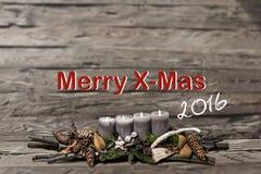 Decorazione di Buon Natale che brucia l'inglese grigio 2016 del messaggio di testo della candela Fotografia Stock
