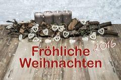 Decorazione di Buon Natale che brucia tedesco grigio 2016 del messaggio di testo della lampada del cuore della neve della candela Fotografia Stock Libera da Diritti