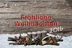 Decorazione di Buon Natale che brucia tedesco grigio 2016 del messaggio di testo della neve della candela Immagini Stock Libere da Diritti