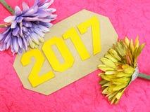 Decorazione di concetto del buon anno con il fiore artificiale Immagine Stock