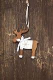 Decorazione di legno d'annata di Natale della renna Immagini Stock